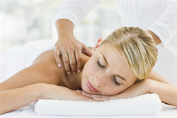 Blonde woman getting shoulder massage at Genesis Career College