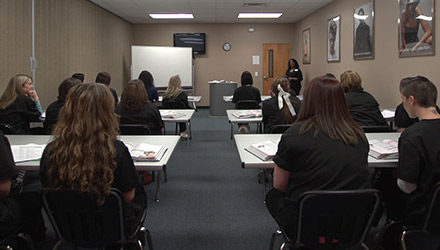 Classroom of students learning in Genesis Career College School of Beauty and Wellness