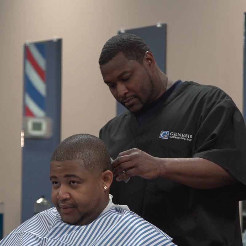 Genesis master barber student giving a haircut