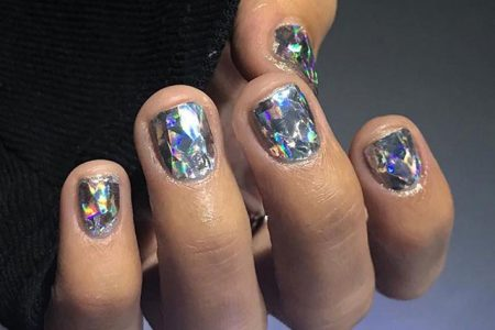 Woman's hand with diamond-inspired nails