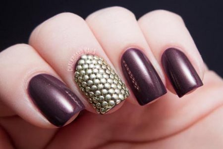 Woman's hand with 3D nail manicure