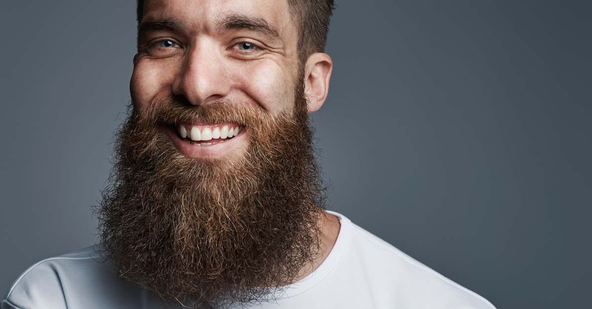 Man with chest-length beard smiling